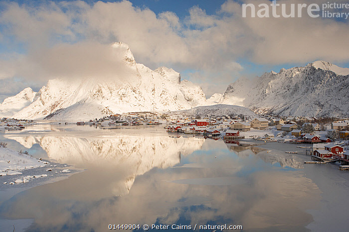 Winter clouds passing over Reine village in Lofoten, Norway, March 2013.  ,  catalogue6,Community,Communities,No One,Nobody,Europe,Northern Europe,North Europe,Nordic Countries,Scandinavia,Norway,Village,Villages,Building,Residential Structure,House,Houses,Coastlines,Mountain,Light,Lights,Light Effect,Reflection,Sky,Cloud,Snow,Landscape,Landscapes,Outdoors,Open Air,Outside,Winter,Day,Coast,Marine,Coastal,Saltwater,Sea,View to land,Fishing Village,Lofoten,Nordland,Reine  ,  Peter Cairns