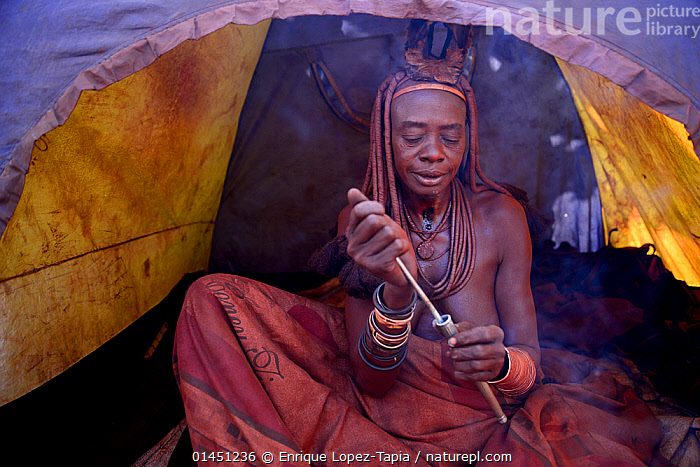 Nature Picture Library - Himba woman snorting nasal snuff
