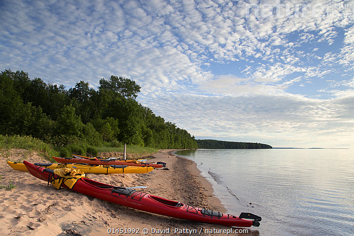 Kayaks on a beach at the edge of Lake Superior, Apostle Islands National Lakeshore, Bayfield peninsula, Wisconsin, USA, July., AMERICAS,NORTH AMERICA,USA,UNITED STATES OF AMERICA,US STATES,AMERICAN STATES,MIDWEST,WISCOSIN,BOAT,BOATS,KAYAK,KAYAKS,COASTLINE,COASTLINES,BEACH,BEACHES,SEASHORE,SHORE,SHORELINE,SHORELINES,SHORES,CLOUDS,CLOUDY,LANDSCAPE,LANDSCAPES,SCENIC,COAST,COASTAL,OPEN BOAT,OPEN BOAT,OPEN BOATS,Weather, David  Pattyn