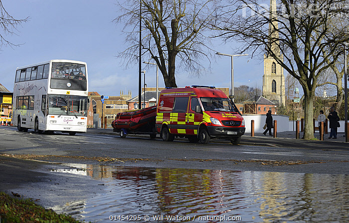 Shuttle bus with rescue vehicle and RIB boat during record breaking floods, New Road, Worcester, England, UK, 13th February 2014.  ,  RESCUE,RESCUES,RESCUING,SAVING,EUROPE,WESTERN EUROPE,WEST EUROPE,UK,BRITAIN,GREAT BRITAIN,UNITED KINGDOM,ENGLAND,WORCESTERSHIRE,WORCESTER,SETTLEMENT,SETTLEMENTS,TOWNS,MODE OF TRANSPORT,VEHICLE,VEHICLES,LAND VEHICLE,LAND VEHICLES,MOTOR VEHICLE,AUTOMOTIVE,MOTORIZED LAND VEHICLES,BUS,BUSES,BOAT,BOATS,MOTORBOATS,POWERBOATS,FLOODED,FLOODING,FLOODS,FLOODWATER,FLOODWATERS,WEATHER,LANDSCAPE,LANDSCAPES,SCENIC,ENVIRONMENT,ENVIRONMENTAL ISSUES,ENVIRONMENTAL ISSUE,ENVIRONMENT ISSUE,ENVIRONMENTAL,GLOBAL WARMING,GLOBAL AFFECT,GREENHOUSE EFFECT,MOTORBOAT,RIB,CLIMATE CHANGE  ,  Will Watson