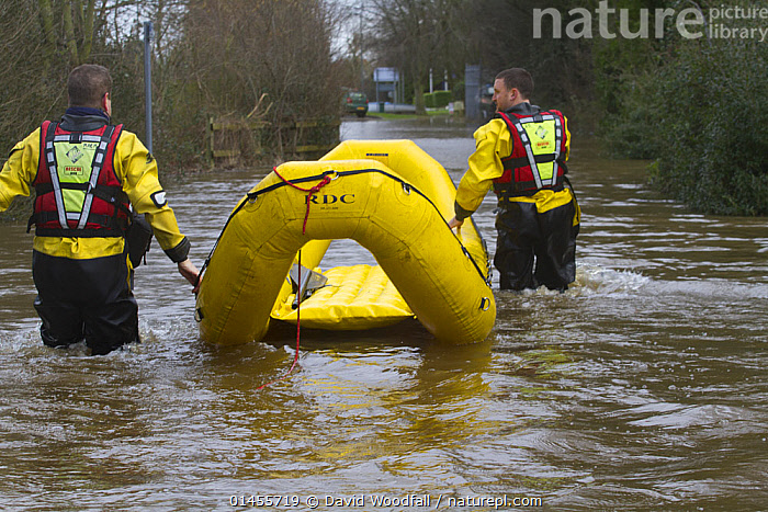 Rescue flood volunteers from Mercia Rescue Service with inflatable raft evacuating home owners during the February 2014 floods, Upton on Severn, Worcestershire, England, UK, 9th February 2014.  ,  PEOPLE,HUMAN,HUMANS,PERSON,PERSONS,MALES,MEN,INFLATABLE,EUROPE,WESTERN EUROPE,WEST EUROPE,UK,BRITAIN,GREAT BRITAIN,UNITED KINGDOM,ENGLAND,WORCESTERSHIRE,BOAT,BOATS,RAFT,FLOATING PLATFORM,FLOATING PLATFORMS,RAFTS,FLOODED,FLOODING,FLOODS,FLOODWATER,FLOODWATERS,WATER,WEATHER,ENVIRONMENT,ENVIRONMENTAL ISSUES,ENVIRONMENTAL ISSUE,GLOBAL WARMING,GREENHOUSE EFFECT,OPEN BOAT,OPEN BOAT,OPEN BOATS,CLIMATE CHANGE,OPEN-BOATS  ,  David  Woodfall
