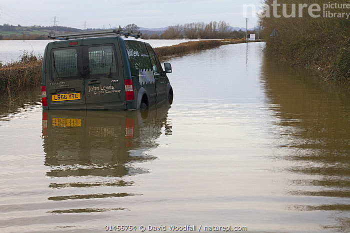 Abandoned van in flooded lane, during February 2014 flooding,  Severn valley, Gloucestershire, England, UK, 7th February 2014. Editorial use only., STRANDED,EUROPE,WESTERN EUROPE,WEST EUROPE,UK,BRITAIN,GREAT BRITAIN,UNITED KINGDOM,ENGLAND,GLOUCESTERSHIRE,MODE OF TRANSPORT,VEHICLE,VEHICLES,LAND VEHICLE,LAND VEHICLES,MOTOR VEHICLE,AUTOMOTIVE,VAN,VANS,FLOODED,FLOODING,FLOODS,FLOODWATER,FLOODWATERS,WATER,WEATHER,ENVIRONMENT,ENVIRONMENTAL ISSUES,ENVIRONMENTAL ISSUE,GLOBAL WARMING,GREENHOUSE EFFECT,CLIMATE CHANGE, David  Woodfall