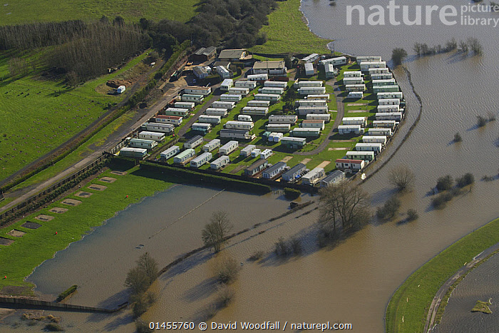 Small caravan park  surrounded by flood water from the River Severn during February 2014 flooding, Worcestershire, England, UK, 7th February 2014., EUROPE,WESTERN EUROPE,WEST EUROPE,UK,BRITAIN,GREAT BRITAIN,UNITED KINGDOM,ENGLAND,WORCESTERSHIRE,AERIAL VIEW,AERIAL SHOTS,AERIALS,BIRDS EYE VIEW,MODE OF TRANSPORT,VEHICLE,VEHICLES,LAND VEHICLE,LAND VEHICLES,MOTOR VEHICLE,AUTOMOTIVE,MOBILE HOME,CARAVAN,CARAVANS,MOBILE HOMES,RECREATIONAL VEHICLE,RECREATIONAL VEHICLES,RV,RVS,TRAILER HOME,TRAILER HOMES,TRAILER,TRAILERS,TRAILOR HOME,TRAILOR HOMES,FLOODED,FLOODING,FLOODS,FLOODWATER,FLOODWATERS,WATER,FLOWING WATER,RIVER,RIVERS,WEATHER,ENVIRONMENT,ENVIRONMENTAL ISSUES,ENVIRONMENTAL ISSUE,GLOBAL WARMING,GREENHOUSE EFFECT,FRESHWATER,CLIMATE CHANGE, David  Woodfall