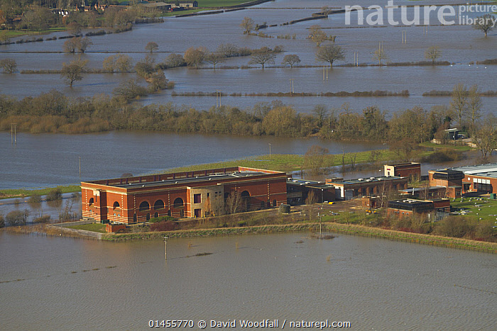 Environment Agency pumping station in Tewkesbury surrounded by extensive flooding following the February 2014 floods, Gloucestershire, England, UK, 7th February 2014., EUROPE,WESTERN EUROPE,WEST EUROPE,UK,BRITAIN,GREAT BRITAIN,UNITED KINGDOM,ENGLAND,GLOUCESTERSHIRE,AERIAL VIEW,AERIAL SHOTS,AERIALS,BIRDS EYE VIEW,BUILDINGS,CULTIVATED LAND,FIELDS,FLOODED,FLOODING,FLOODS,FLOODWATER,FLOODWATERS,WATER,WEATHER,ENVIRONMENT,ENVIRONMENTAL ISSUES,ENVIRONMENTAL ISSUE,GLOBAL WARMING,GREENHOUSE EFFECT,FARMLAND,CLIMATE CHANGE, David  Woodfall