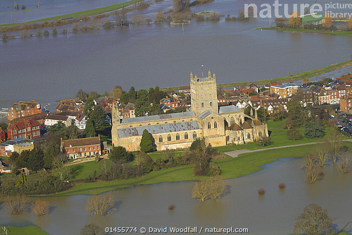 Tewkesbury Abbey surrounded with flooded town and meadows following February 2014 Severn Valley floods, Gloucestershire, England, UK, 7th February 2014.  ,  AERIAL VIEW,AERIAL SHOTS,AERIALS,BIRDS EYE VIEW,SETTLEMENT,SETTLEMENTS,TOWNS,BUILDINGS,CHURCHES,ABBEYS,FLOODED,FLOODING,FLOODS,FLOODWATER,FLOODWATERS,WATER,WEATHER,ENVIRONMENT,ENVIRONMENTAL ISSUES,ENVIRONMENTAL ISSUE,GLOBAL WARMING,GREENHOUSE EFFECT,CLIMATE CHANGE,Europe,United Kingdom  ,  David  Woodfall
