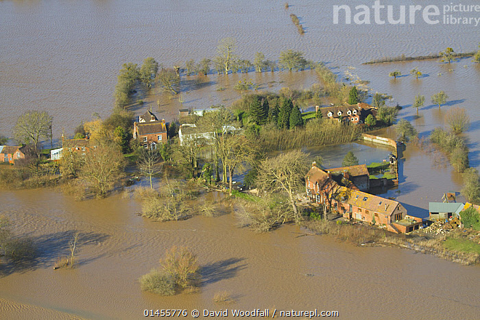 Farm flooded by River Severn during February 2014 floods, Gloucestershire, England, UK, 7th February 2014., EUROPE,WESTERN EUROPE,WEST EUROPE,UK,BRITAIN,GREAT BRITAIN,UNITED KINGDOM,ENGLAND,GLOUCESTERSHIRE,AERIAL VIEW,AERIAL SHOTS,AERIALS,BIRDS EYE VIEW,FARMS,CULTIVATED LAND,FIELDS,FLOODED,FLOODING,FLOODS,FLOODWATER,FLOODWATERS,WATER,WEATHER,ENVIRONMENT,ENVIRONMENTAL ISSUES,ENVIRONMENTAL ISSUE,GLOBAL WARMING,GREENHOUSE EFFECT,FARMLAND,CLIMATE CHANGE, David  Woodfall