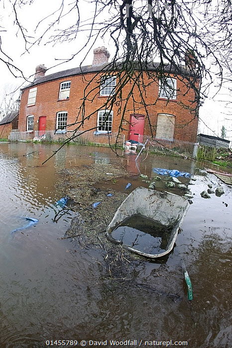 Fish eye view of flooded house with wheel barrow during the February 2014 floods, Upton upon Severn, Worcestershire, England, UK, 9th February 2014., EUROPE,WESTERN EUROPE,WEST EUROPE,UK,BRITAIN,GREAT BRITAIN,UNITED KINGDOM,ENGLAND,WORCESTERSHIRE,BUILDINGS,HOUSES,FLOODED,FLOODING,FLOODS,FLOODWATER,FLOODWATERS,WATER,WEATHER,ENVIRONMENT,ENVIRONMENTAL ISSUES,ENVIRONMENTAL ISSUE,GLOBAL WARMING,GREENHOUSE EFFECT,FISH EYE,FISH EYE,CLIMATE CHANGE, David  Woodfall