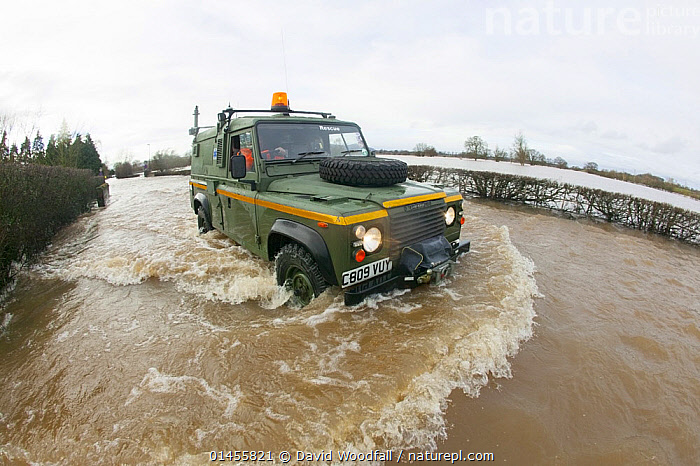 Mercia Rescue Landrover driving through flood waters to help home owners during February 2014 floods, 9th February 2014.  ,  RESCUE,RESCUES,RESCUING,SAVING,EUROPE,WESTERN EUROPE,WEST EUROPE,UK,BRITAIN,GREAT BRITAIN,UNITED KINGDOM,ENGLAND,WORCESTERSHIRE,VEHICLE,VEHICLES,LAND VEHICLE,LAND VEHICLES,MOTOR VEHICLE,CAR,CARS,OFF ROAD VEHICLE,4X4,4X4S,FOUR BY FOUR,FOUR BY FOURS,JEEP,JEEPS,OFF ROAD VEHICLE,OFF ROAD VEHICLES,SPORTS UTILITY VEHICLE,SUV,SUVS,FLOODED,FLOODING,FLOODS,FLOODWATER,FLOODWATERS,WEATHER,ENVIRONMENT,ENVIRONMENTAL ISSUES,ENVIRONMENTAL ISSUE,GLOBAL WARMING,GREENHOUSE EFFECT,CLIMATE CHANGE  ,  David  Woodfall
