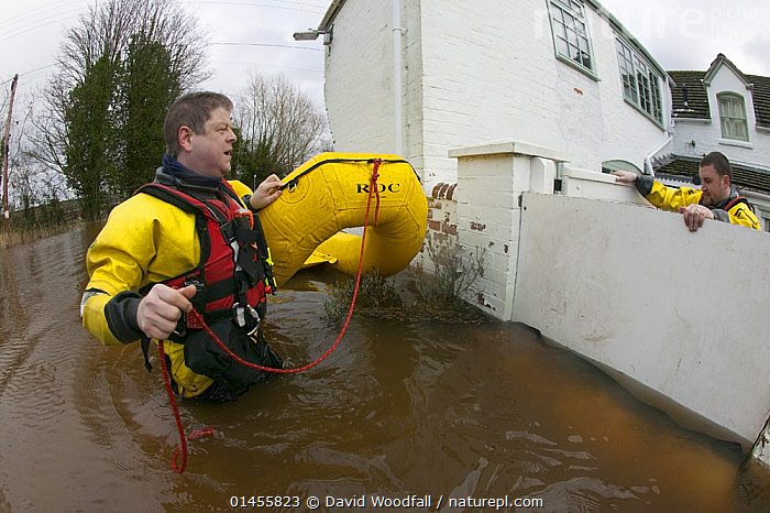 Rescue workers entering property from safety of  lightweight boat to check property for its safety and rescue homeowners in February 2014 flood of properties by River Severn., PEOPLE,HUMAN,HUMANS,PERSON,PERSONS,MALES,MEN,RESCUE,RESCUES,RESCUING,SAVING,INFLATABLE,EUROPE,WESTERN EUROPE,WEST EUROPE,UK,BRITAIN,GREAT BRITAIN,UNITED KINGDOM,ENGLAND,WORCESTERSHIRE,BUILDINGS,HOUSES,BOAT,BOATS,RAFT,FLOATING PLATFORM,FLOATING PLATFORMS,RAFTS,FLOODED,FLOODING,FLOODS,FLOODWATER,FLOODWATERS,WEATHER,ENVIRONMENT,ENVIRONMENTAL ISSUES,ENVIRONMENTAL ISSUE,GLOBAL WARMING,GREENHOUSE EFFECT,OPEN BOAT,OPEN BOAT,OPEN BOATS,CLIMATE CHANGE,OPEN-BOATS, David  Woodfall