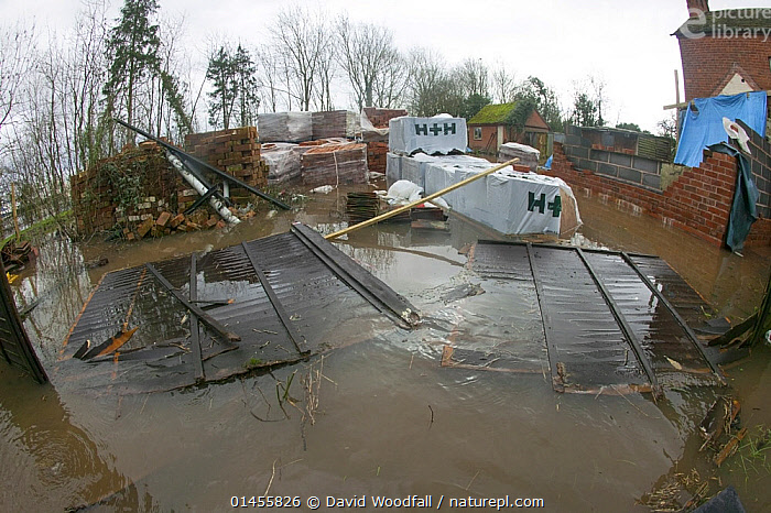 Garden with building materials during the February 2014 floods, Upton upon Severn, Worcestershire, England, UK, 9th February 2014., DAMAGED,DAMAGE,EUROPE,WESTERN EUROPE,WEST EUROPE,UK,BRITAIN,GREAT BRITAIN,UNITED KINGDOM,ENGLAND,WORCESTERSHIRE,GARDENS,CONSTRUCTION MATERIAL,BRICK,BRICKS,FLOODED,FLOODING,FLOODS,FLOODWATER,FLOODWATERS,WEATHER,ENVIRONMENT,ENVIRONMENTAL ISSUES,ENVIRONMENTAL ISSUE,GLOBAL WARMING,GREENHOUSE EFFECT,FISH EYE,FISH EYE,CLIMATE CHANGE, David  Woodfall
