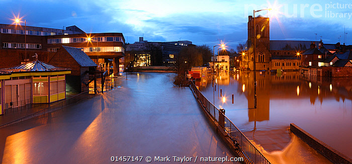 Guildford flooded by River Wey at night, during the 2013 Christmas floods. Surrey, England, 25th December 2013. Digitally enhanced image.  ,  catalogue6,Atmospheric Mood,Atmospheric,No One,Nobody,Europe,Western Europe,UK,Great Britain,England,Surrey,Guildford,Horizontal,Panoramic,High Angle View,Lighting,Electric Light,Street Light,City,Town,Towns,Road,Building,Building Exterior,Flood,Flowing Water,River,Weather,Landscape,Landscapes,Outdoors,Open Air,Outside,Winter,Twilight,Evening,Night,Nocturnal,Insurance,Insured,Environment,Environmental Issues,Global Warming,Greenhouse Effect,Freshwater,Bad Weather,Severe weather,Climate change,Dusk,Elevated view,Lit Up,United Kingdom  ,  Mark Taylor