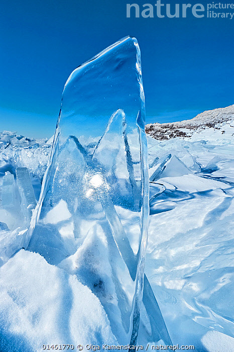 Clear pane of ice, Lake Baikal, Siberia, Russia, March.  ,  catalogue6,Thawing,Freshness,Fresh,Frozen,No One,Nobody,See Through,Transparent,Temperature,Cold,Chill,Chilly,Russia,Siberia,Vertical,Close Up,Sky,Clear Sky,Ice,Ice Formation,Snow,Outdoors,Open Air,Outside,Season,Seasons,Winter,Day,Freshwater,Lake,Lake Baikal,Blue sky,View Through  ,  Olga Kamenskaya