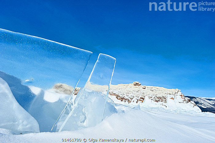 Clear panes of ice on Lake Baikal, Siberia, Russia, March., catalogue6,Freshness,Fresh,Separation,Divide,Divided,Division,Separate,Separated,Damaged,Broken,Break,Frozen,No One,Nobody,Cracked,See Through,Sharp,Transparent,Temperature,Cold,Chill,Chilly,Russia,Siberia,Copy Space,Close Up,Sky,Clear Sky,Ice,Ice Formation,Snow,Season,Seasons,Winter,Freshwater,Lake,Lake Baikal,Negative space,Blue sky,View Through, Olga Kamenskaya
