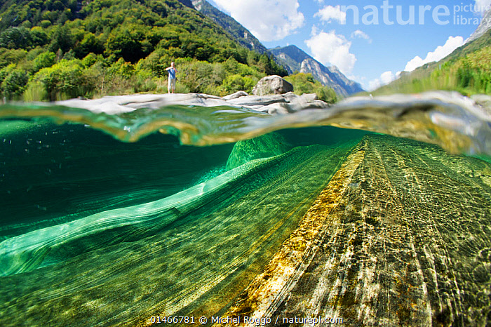 Split level view of blue green waters of Verzasca River flowing over granite rocks at Lavertezzo, Canton Tessin, Switzerland, September. Taken for the Freshwater Project.  ,  EUROPE,WESTERN EUROPE,SWITZERLAND,ROCK,ROCKS,IGNEOUS ROCKS,VOLCANIC ROCKS,FLOWING WATER,RIVER,FRESHWATER,UNDERWATER,SPLIT LEVEL,WATER,TEMPERATE,UNDERWATER,FRESHWATER PROJECT,VERZASCA,, catalogue11  ,  Michel  Roggo