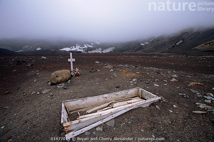 Graves at the now abandoned British Antarctic Survey station and Whaling station, Whalers Bay, Deception Island, Antarctica  ,  MOOD,MOODS,OMINOUS,FOREBODING,ANTARCTICA,ANTARCTIC,POLAR,GRAVE,GRAVES,MOUNTAIN,CLOUD,MIST,LANDSCAPE,LANDSCAPES,HISTORY,TUNDRA,HISTORIC,HISTORICAL  ,  Bryan and Cherry Alexander