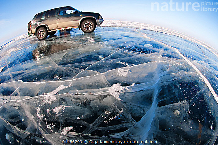 Wide angle view of vehicle parked on ice on lake surface. Lake Baikal, Siberia, Russia, March 2007., high15,,,Adventure,Adventures,Adventurous,Risky,Frozen,Nobody,Cracked,Temperature,Cold,Russia,Siberia,Side View,Wide Angle,Land Vehicle,Motor Vehicle,Cars,Ice,Landscape,Landscapes,Outdoors,Open Air,Outside,Winter,Day,Exploration,Freshwater,Lake,Water,Lake Baikal,Precarious,Surface,One Object,, Olga Kamenskaya
