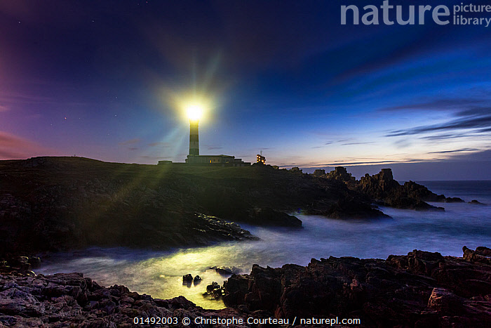 Light of the Creac'h Lighthouse at night. Ile d'Ouessant / Ushant, Finistere, Brittany, France, September 2011.  ,  high15,,,Atmospheric Mood,Atmospheric,Guidance,Guiding,Help,Mystery,Mysterious,Colour,Blue,Nobody,Luminosity,Bright,Brightness,Vivid,Vividness,Europe,Western Europe,France,Brittany,Building,Lighthouse,Lighthouses,Peninsula,Promontory,Light,Lights,Reflection,Sky,Landscape,Landscapes,Outdoors,Open Air,Outside,Night,Coast,Marine,Coastal,Water,Saltwater,Sea,Precaution,Maritime,Finistere,Rocky,Bretagne,Blue Colour,Ushant,  ,  Christophe Courteau