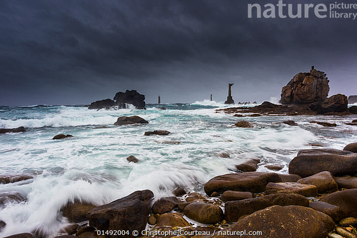 Storm at 'Pointe de Pern', Ile d'Ouessant / Ushant. Nividic lighthouse visible in distance. Finistere, Brittany, France, September 2011.  ,  high15,,,Mood,Ominous,Foreboding,Nobody,Europe,Western Europe,France,Brittany,Photographic Effect,Long Exposure,Building,Lighthouse,Lighthouses,Rock,Boulder,Boulders,Sky,Cloud,Storm Cloud,Ocean,Atlantic Ocean,Wave,Weather,Storm,Sea Scenes,Sea Scenics,Sea View,Seascapes,Waterscape,Outdoors,Open Air,Outside,Winter,Day,Coast,Marine,Coastal,Water,Bad Weather,Temperate,Saltwater,Sea,Heavy seas,Severe weather,View to sea,Surface,Finistere,Rocky,Bretagne,Pointe de Pern,Ushant,  ,  Christophe Courteau