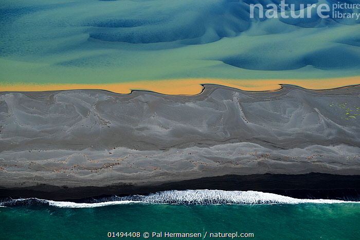Aerial view of river delta and coast, South West Iceland, June 2014.  ,  catalogue7,Imagination,Imaginative,Colour,Blue,Turquoise,Aqua,Aqua Blue,Torquoise,Yellow,Nobody,Pattern,Patterned,Patterns,Shape,Shapes,Swirl,Swirling,Swirls,Europe,Northern Europe,North Europe,Nordic Countries,Scandinavia,Iceland,Aerial View,High Angle View,Sky,Flowing Water,River,Wave,Landscape,Landscapes,Outdoors,Open Air,Outside,Twilight,Evening,Backgrounds,Background,Coast,Freshwater,Marine,Coastal,Water,Arty shots,Abstract,Abstracts,Saltwater,Sea,Dusk,Elevated view,Delta,Deltas,Dreamscape,Land,Blue Colour,Yellow Colour  ,  Pal Hermansen