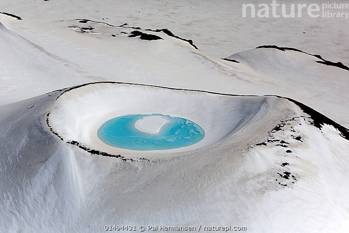 Aerial view of crater lake in snowy mountain, near Landmannalaugar, Iceland, June 2014.  ,  high15,,,Astonishing,Spectacular,Freshness,Fresh,Simplicity,Colour,Blue,Nobody,Shape,Shapes,Circle,Europe,Northern Europe,North Europe,Nordic Countries,Scandinavia,Iceland,Aerial View,High Angle View,Craters,Mountain,Summit,Snow,Landscape,Landscapes,Outdoors,Open Air,Outside,Winter,Day,Freshwater,Lake,Water,Geology,Elevated view,Blue Colour,Secluded,,,Beauty in nature,,,beauty in nature,  ,  Pal Hermansen