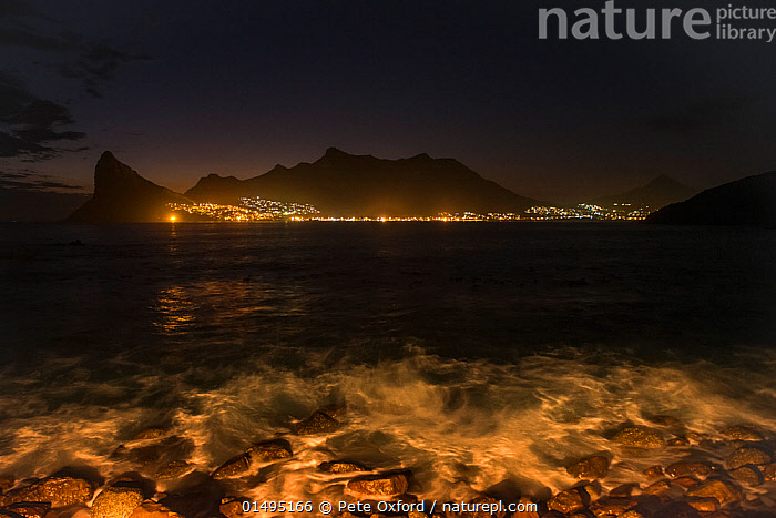Hout Bay harbor at night, Western Cape, South Africa, May 2014., catalogue7,Magic,Magical,Mystery,Mysterious,Shallow,Nobody,Dark,Darkness,Africa,Southern Africa,South Africa,Harbour,Skyline,Skylines,Light,Lights,Rock,Landscape,Landscapes,Outdoors,Open Air,Outside,Night,Coast,Coastal,Cape floristic region,Biodiversity hotspots,Biodiversity hotspot,View to land,South African,Lit Up,Hout Bay, Pete Oxford