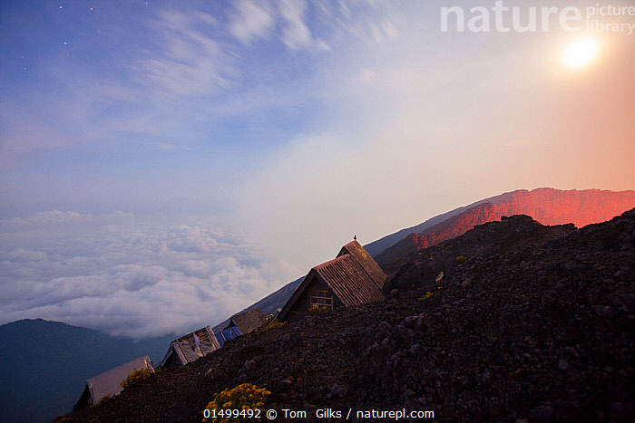 Huts for tourists to sleep in on the edge of Nyiragongo volcano at night, Virungas National Park, Democratic Republic of Congo February 2015.  ,  AFRICA,CENTRAL AFRICA,REPUBLIC OF THE CONGO,BUILDING,HUT,HUTS,CRATERS,NIGHT,TRAVEL,VACATIONS,TOURISM,GEOLOGY,GEOTHERMAL  ,  Tom  Gilks