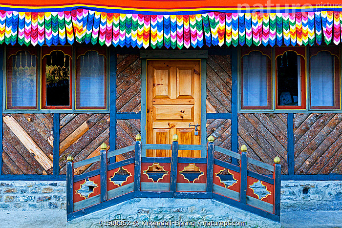 Doorway of the poet Dilgo Khyentse Rinpoche's house, near Paro, Bhutan, October 2014.  ,  high15,,,Symmetry,Traditional,Colour,Colourful,Colorful,Nobody,Asia,Indian Subcontinent,Bhutan,Building,Building Exterior,Residential Structure,House,Houses,Entrance,Doorway,Door,Doors,Front Door,Entrance Door,Entrance Doors,Front Doors,Wall,Facade,Facades,Front,Outdoors,Open Air,Outside,Day,Architecture,Culture,Asian Culture,Dilgo Khyentse Rinpoc,  ,  Kirkendall-Spring