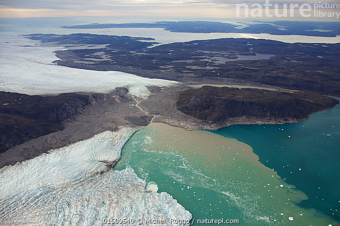 Aerial view of the Sermeq Kujalleq Glacier or Jakobshavn Isbrae, entering the sea, near Ilulissat, UNESCO World Heritage Site, Kalaallit Nunaat, Greenland. August 2014. Photographed for The Freshwater Project  ,  THAWING,TEMPERATURE,COLD,CHILL,CHILLY,AERIAL VIEW,BIRDS EYE VIEW,HIGH ANGLE VIEW,ICE,ENVIRONMENT,ENVIRONMENTAL ISSUES,GLOBAL WARMING,GREENHOUSE EFFECT,COAST,COASTAL,COLD WATER,CLIMATE CHANGE,PROTECTED AREA,UNESCO WORLD HERITAGE SITE,UNESCO,HERITAGE SITE,WORLD HERITAGE SITE,WILDERNESS,COLDWATER,ELEVATED VIEW,ICE CAP,FRESHWATER PROJECT  ,  Michel  Roggo