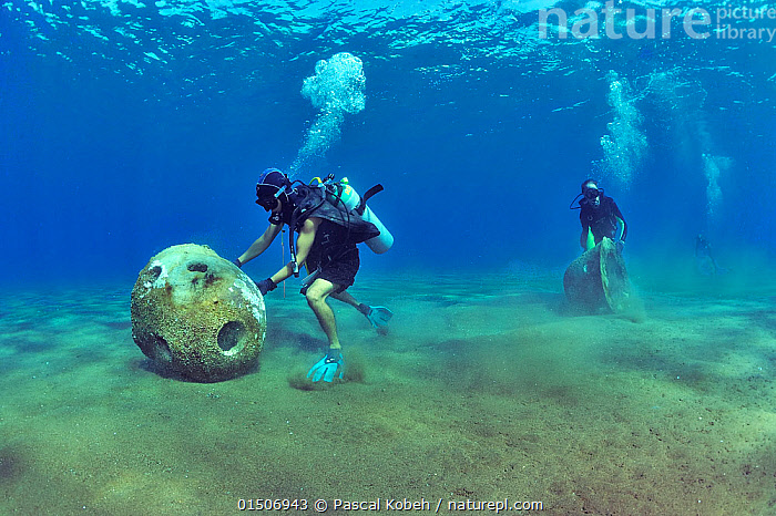 Divers are setting up concrete reef balls to build an artificial reef, Philippines, Sulu Sea. August 2014.  ,  high15,,,Diving,Rolling,Positioning,Placing,Position,Underwater Diving,Scuba Diving,Working,People,Man,Asia,South East Asia,Republic of the Philippines,Equipment,Tropical,Reef,Reefs,Coral Reef,Coral Reefs,Bubble,Ocean,Pacific Ocean,Restoration,Marine,Underwater,Water,Conservation,Indo Pacific,Saltwater,Sea,Biodiversity hotspots,Biodiversity hotspot,Tropics,Philippines,Nature Reclamation,Nature taking over,Moving,Sulu Sea,Artificial Reef,Breathing Apparatus,Artificial reef,  ,  Pascal Kobeh