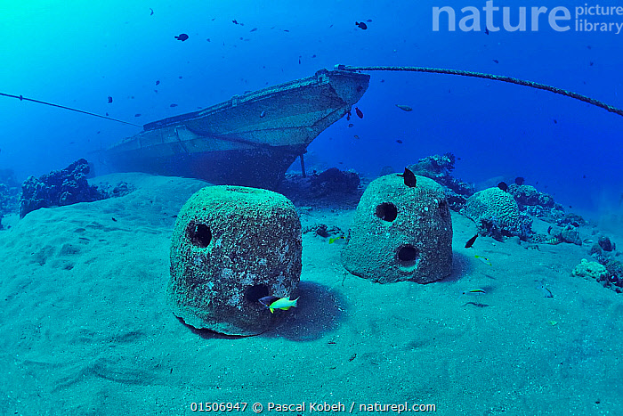 Concrete reef balls and boat sunk to build an artificial reef, Philippines, Sulu Sea. August 2014.  ,  People,Wreck,Wreckage,Shipwreck,Boat,Boats,Ocean,Pacific Ocean,Marine,Water,Indo Pacific,Saltwater,Sea,Nature taking over,Sulu Sea,Artificial Reef,Nature reclamation  ,  Pascal Kobeh
