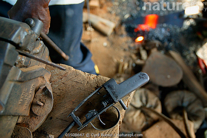 Blacksmith forging handgun, Boje Village, Cross River State, Nigeria., Africa,West Africa,Nigeria,Federal Republic of Nigeria,Equipment,Weaponry,Weapon,Weapons,Building,Workshop,Workshops,Blacksmith Shop,Blacksmith Shops,Blacksmiths Shop,Blacksmiths Shops,Forge,Forges,Smithies,Smithy,Culture,West African, Cyril Ruoso