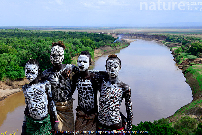 Karo boys with decorative skin painting. Karo tribe, Omo river, Ethiopia, November 2014  ,  high15,,,People,African Descent,East African Descent,Ethiopian Ethnicity,Native African Ethnicity,Only Boys,Friendship,Traditional,Ornate,Decorative,Ornamental,Colour,White,Side By Side,Few,Four,Group,Group Of People,Small Group Of People,4 People,Africa,East Africa,Ethiopia,High Angle View,Portrait,Skin,Body Paint,Horizon,Horizon Over Land,Horizons Over Land,Flowing Water,River,Landscape,Landscapes,Outdoors,Open Air,Outside,Day,Nature,Natural,Natural World,Open Space,Open Spaces,Scenery,View,Views,Vista,Culture,African Culture,African,Indigenous Culture,Freshwater,Water,Forest,Tribes,Elevated view,Direct Gaze,White colour,Native African culture,Arm around,Omo River,  ,  Enrique Lopez-Tapia