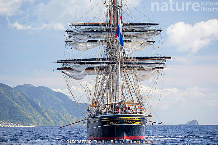 Three-masted clipper cruising ship 'Stad Amsterdam', Dominica, Caribbean Sea, Atlantic Ocean. All non-editorial uses must be cleared individually., high15,,,Nobody,Styles,Old-Fashioned,Old Fashioned,Outdated,The Caribbean,Front View,View From Front,Boat,Boats,Sailboat,Sail Boat,Sail Boats,Sailboats,Sailing Boat,Sailing Boats,Sailing Ship,Sailing Ships,Mast,Masts,Ocean,Caribbean Sea,Outdoors,Open Air,Outside,Day,Marine,Water,Tall ship,Saltwater,Sea,Boat Part,Biodiversity hotspots,Dominica,Maritime,Three Masted,, Franco  Banfi