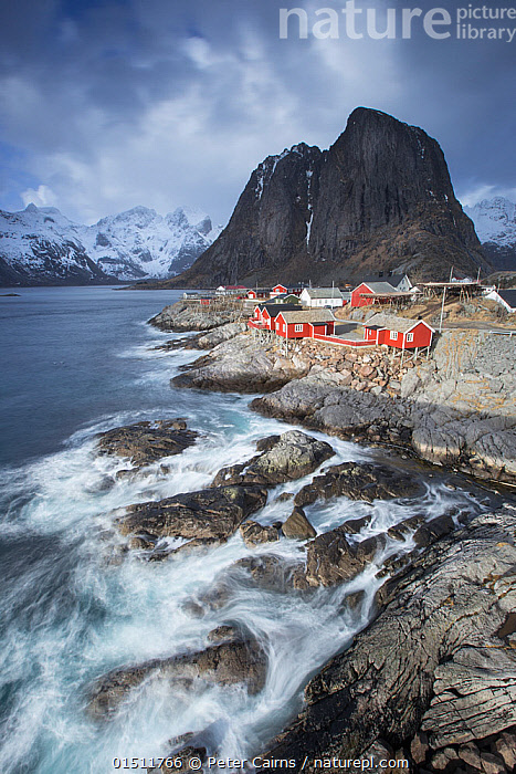 View over fishing village of Hamnoya, Lofoten, Norway. March 2015., catalogue8,,,Community,Communities,Famous Place,Landmark,Nobody,Europe,Northern Europe,North Europe,Nordic Countries,Scandinavia,Norway,Vertical,High Angle View,Photographic Effect,Blurred Motion,Blurred Movement,Long Exposure,Settlement,Village,Villages,Building,Building Exterior,Residential Structure,House,Houses,Coastlines,Peninsula,Promontory,Rock Formations,Light,Lights,Sunlight,Weather,Overcast,Landscape,Landscapes,Outdoors,Open Air,Outside,Day,Coast,Marine,Coastal,Water,Geology,Saltwater,Sea,Elevated view,Fishing Village,Lofoten,Nordland,Hamnoya,, Peter Cairns