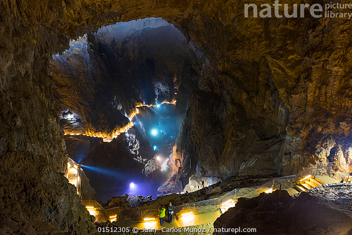 Tourists looking down onto underground stream, from illuminated pathway, Skocjan Caves, Green Karst, Slovenia, October 2014.  ,  high15,,,People,Woman,Recreation Role,Tourist,Tourists,Incidental People,Incidental Person,People In The Background,Background People,Background Person,People In Background,Person In Background,Confusion,Mystery,Mysterious,Phobia,Phobias,Scale,Proportion,Dark,Darkness,Dizzy,Dizziness,Vertigo,Size,Large,Big,Europe,Southern Europe,Slovenia,Interior,Path,Cave,Rock Formations,Light,Lights,Flowing Water,River,Stream,Streams,Outdoors,Open Air,Outside,Travel,Vacations,Tourism,Freshwater,Water,Geology,Insignificant,Lit Up,Karst,Gradient,Downhill,Green Karst,Skocjan Caves,  ,  Juan  Carlos Munoz