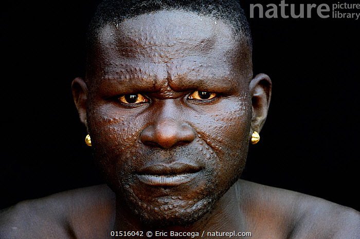 Toposa tribe man with elaborate facial skin scarifications, Omo Valley, Ethiopia, March 2015., high15,,,People,African Descent,East African Descent,Ethiopian Ethnicity,Native African Ethnicity,Man,Only Men,One Man,Traditional,1 Person,Single,Single Person,Worried,Serious,Africa,East Africa,Ethiopia,Portrait,Jewelry,Jewellery,Jewellry,Earring,Earing,Earings,Earrings,Outdoors,Open Air,Outside,Day,Culture,Indigenous Culture,Tribes,Direct Gaze,Body modification,Scars,Scarred,Scarification,Decorative scars,Toposa,, Eric Baccega