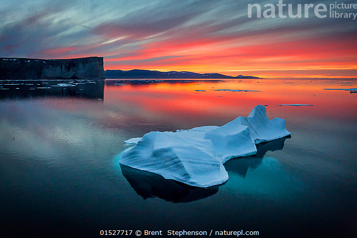 Sunset off Scott Island, with floating pieces of sea ice, Scott Inlet, Baffin Island, Canadian Arctic, August 2015.  ,  catalogue8,,,Floating,Atmospheric Mood,Atmospheric,Colour,Orange,Pink,Yellow,Nobody,North America,Canada,Nunavut,Arctic,Polar,Back Lit,Backlit,Harbour,Reflection,Sky,Moody Sky,Dramatic Sky,Bay,Bays,Inlets,Ice,Iceberg,Icebergs,Weather,Meteorology,Sunset,Setting Sun,Sunsets,Landscape,Landscapes,Outdoors,Open Air,Outside,Twilight,Evening,Culture,Canadian Culture,Canadian,Coast,Marine,Coastal,Water,Silhouette,Saltwater,Sea,Dusk,Sea ice,Baffin Island,Yellow Colour,Harbour Wall,Scott Island (Nunavut,Canada),Scott Inlet,  ,  Brent  Stephenson