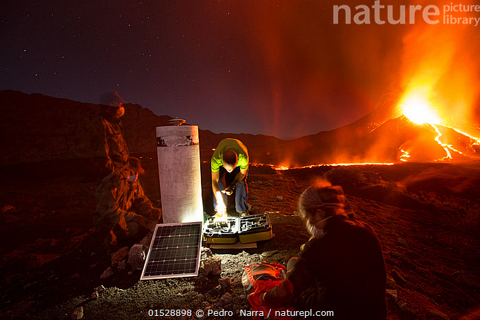 Scientists observing lava and ash plume erupting from Fogo Volcano, Fogo Island, Cape Verde, 29th November 2014., catalogue8,,,Measuring,Erupting,Working,People,Man,Scientist,Scientists,Research,Researching,Colour,Orange,Group,Group Of People,Small Group Of People,Few,4 People,Luminosity,Glow,Glows,Temperature,Hot,Africa,West Africa,Cape Verde,Rock,Lava,Outdoors,Open Air,Outside,Night,Technology,Geology,Geothermal,West African,Lit Up,Bending,Bending forwards,Fogo Volcano,Fogo Island,, Pedro  Narra