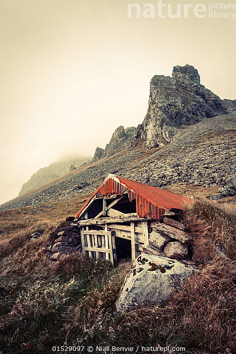 Abandoned shelter near Stokkness, Iceland, September 2015., Mood,Desolation,Desolate,Shelter,Abandoned,Nobody,Europe,Northern Europe,North Europe,Nordic Countries,Scandinavia,Iceland,Copy Space,Sepia,Sepia Tone,Sepia Tones,Sepia Toning,Vertical,Building,Mountain,Negative space,Moods,Copy Spaces,Buildings,Mountainous,Mountains, catalogue9, Niall Benvie