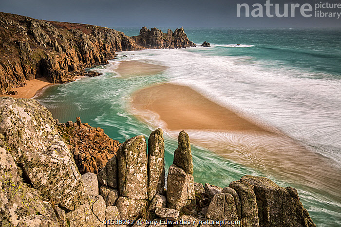 Logan Rock from Treen Cliff, Porthcurno,Cornwall, England, UK. February 2015.  ,  Nobody,Europe,Western Europe,UK,Great Britain,England,Cornwall,High Angle View,Promontory,Beach,Rock Formations,Tide,Tides,Ocean,Atlantic Ocean,Wave,Outdoors,Day,Coast,Marine,Cove,Coastal,Water,Geology,Saltwater,Sea,Elevated view,Tidal,Maritime,Waves,Scenics,Views,Coasts,Oceans,Seas,Coves, catalogue9  ,  Guy Edwardes