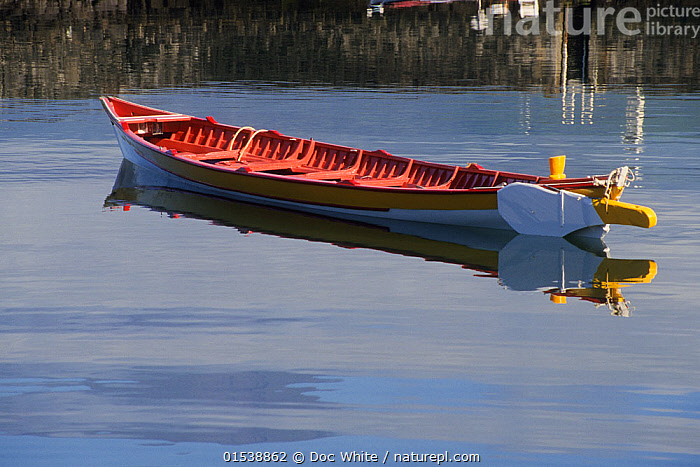 Small  whaling boat on calm water, Azores Islands, Portugal.  ,  Boat,Boats,Reflection,Environment,Environmental Issues,Atlantic Islands,Azores,Whale hunting,  ,  Doc White