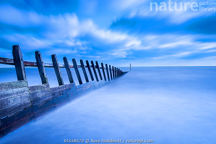 RF - Groyne at Dawlish Warren, Devon, UK. January 2016. (This image may be licensed either as rights managed or royalty free.)  ,  Atmospheric Mood,Mood,Ominous,Foreboding,Mystery,Colour,Blue,Nobody,Europe,Western Europe,UK,Great Britain,England,Devon,Copy Space,Diminishing Perspective,Groyne,Coastal Groin,Coastal Groins,Groin,Groins,Waterbreak,Waterbreaks,Wood,Wooden,Horizon,Horizon Over Water,Sky,Cloud,Outdoors,Day,Marine,Water,Saltwater,Sea,Sea defences,Sea defence,View to sea,Negative space,Precaution,Surreal,RF,Royalty free,RFCAT1,RF17Q1,Dawlish Warren,  ,  Ross Hoddinott