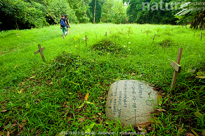 Two volunteers walking away from graves at the Moon bear cementery, Animals Asia Foundation, China, September 2011., People,Charity,Aid,Charitable,Sadness,Asia,East Asia,China,Symbol,Spiritual Symbol,Cross,Cemetery,Conservation,Volunteer,Volunteering,Volunteers,, Inaki  Relanzon