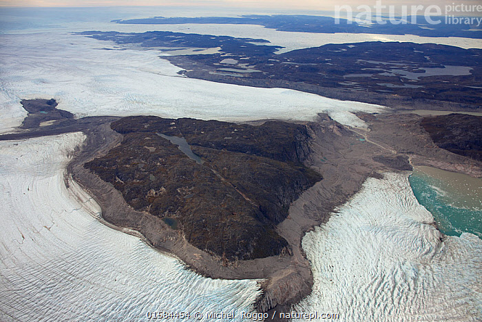 Aerial view of the Sermeq Kujalleq Glacier or Jakobshavn Isbrae, entering the sea, near  Ilulissat Icefjord UNESCO World Heritage Site, Greenland. August 2014 Photographed for the Freshwater Project.  ,  Arctic,Polar,Aerial View,High Angle View,Ice,Iceberg,Icebergs,Landscape,Coast,Freshwater,Marine,Coastal waters,Coastal,Water,Saltwater,Protected area,UNESCO World Heritage Site,Elevated view,Freshwater Project,Sea ice,Sermeq Kujalleq,Kalaallit Nunaat,  ,  Michel  Roggo