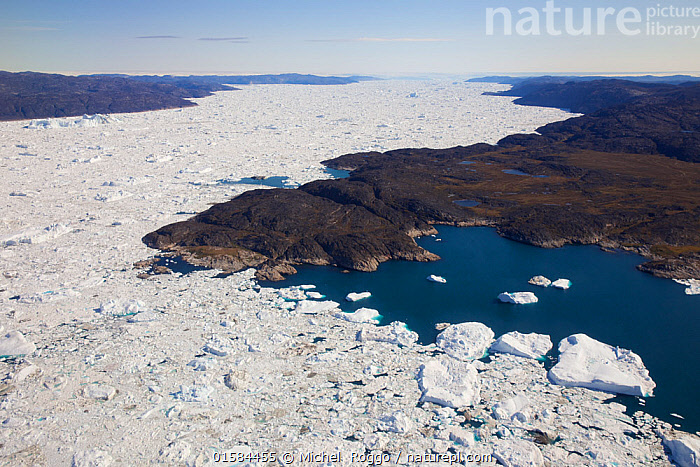 Aerial view of the Ilulissat Icefjord, with the Sermeq Kujalleq Glacier or Jakobshavn Isbrae entering the sea, near  Ilulissat Icefjord UNESCO World Heritage Site, Greenland. August 2014. Photographed for The Freshwater Project  ,  Arctic,Polar,Aerial View,High Angle View,Ice,Iceberg,Icebergs,Landscape,Coast,Freshwater,Marine,Coastal waters,Coastal,Water,Saltwater,Protected area,UNESCO World Heritage Site,Elevated view,Freshwater Project,Sea ice,Sermeq Kujalleq,Kalaallit Nunaat,  ,  Michel  Roggo