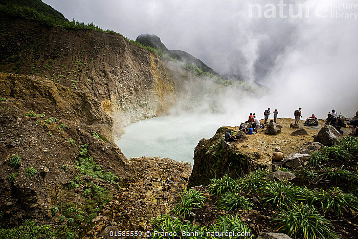 People watching the 'Boiling Lake', a flooded fumarole 10.5 km east of Roseau, Morne Trois Pitons National Park, UNESCO World Heritage Site, Dominica. February 2015.  ,  People,Adventure,The Caribbean,Steam,Steaming,Hikers,Travel,Tourism,Eco Tourism,Water,Reserve,Biodiversity hotspots,Geothermal,Protected area,UNESCO World Heritage Site,National Park,Dramatic,Fumaroles,Dominica,  ,  Franco  Banfi