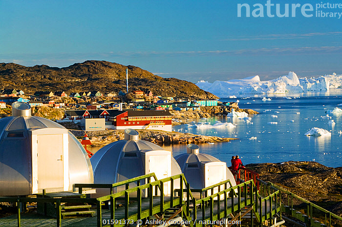 Igloos outside the Arctic Hotel, Ilulissat UNESCO World Heritage Site,  Greenland. July 2008., climate change,global warming,Greenland,Arctic,Illulissat,Unesco world heritage site,landscape,iceberg,coast,sea,arctic ocean,summer,Illulissat ice fjord,sermeq kujalleq,Inuit,Jacobshaven,Jacobshaven glacier,isbrae,fjord,igloo,accomodation,Arctic Hotel,hotel,view,view point,vista,light,midnight sun,,,,, Ashley Cooper
