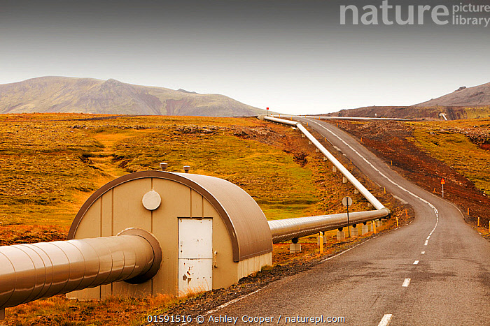 A pipeline taking geothermally heated hot water from Hellisheidi geothermal power station in Hengill, to Reykjavik, Iceland. September 2010.  ,  Iceland,power station,power,electricity,energy,geothermal,geothermal energy,geothermal electricity,steam,steaming,heat,hot,bore hole,tapping,borehole,pipe,piping,temperature,geothermal power,vulcanicty,Svartsengi,climate change,global warming,carbon footprint,carbon neutral,geology,plate tectonics,tectonic,Hellisheidi power station,lava,lava field,lava flow,magma,rock,Hengill,pipeline,road,tarmac,,,,  ,  Ashley Cooper