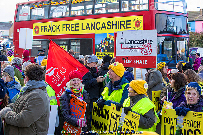 Protesters campaigning against fracking by Cuadrilla, as Cuadrilla appeals the local council decision not to allow fracking. Lancashire, England, UK, February 2016., fracking,shale gas,Blackpool,Lancashire,UK,protest,fossil fuel,climate change,global warming,banner,placard,concern,environment,environmentalist,yellow,colourful,gas,energy,energy policy,planning,planning application,planning appeal,Cuadrilla,David and Goliath,battle,localism,democracy,person,man,woman,concerned,green,red,bus,double decker,double decker bus,battle bus,,,People,, Ashley Cooper