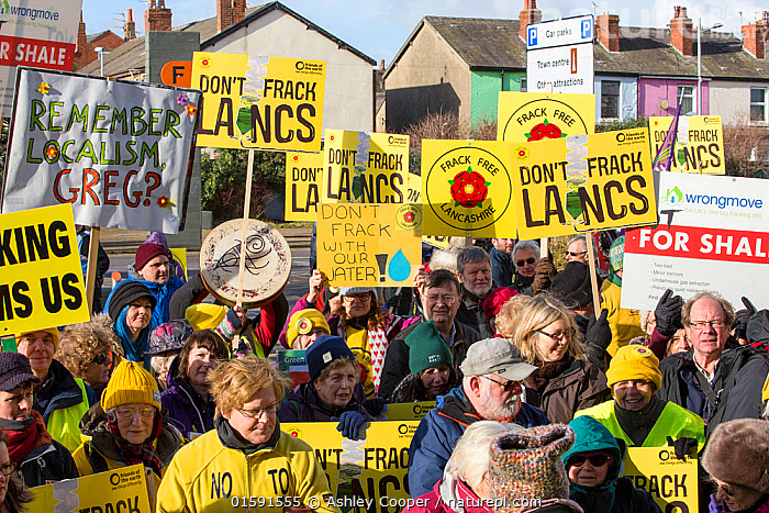 Protesters campaigning against fracking by Cuadrilla, as Cuadrilla appeals the local council decision not to allow fracking. Lancashire, England, UK, February 2016.  ,  fracking,shale gas,Blackpool,Lancashire,UK,protest,fossil fuel,climate change,global warming,banner,placard,concern,environment,environmentalist,yellow,colourful,gas,energy,energy policy,planning,planning application,planning appeal,Cuadrilla,David and Goliath,battle,localism,democracy,person,man,woman,concerned,green,,,People,,, catalogue11  ,  Ashley Cooper